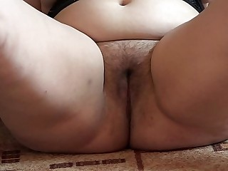 A fat girl masturbates her..