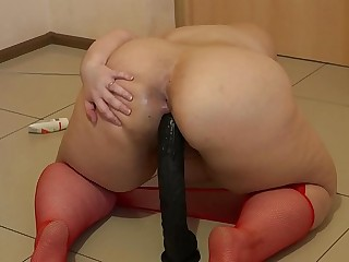 A fat girl in red pantyhose..